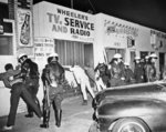 confrontations-Police-men-Watts-district-police-residents-March-1966.jpg